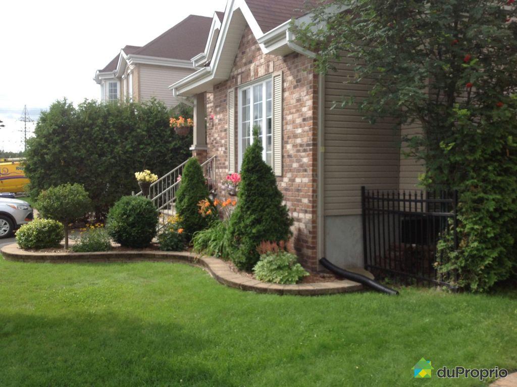 Maison vendre fabreville 3409 rue isabelle immobilier for Devant de maison paysager