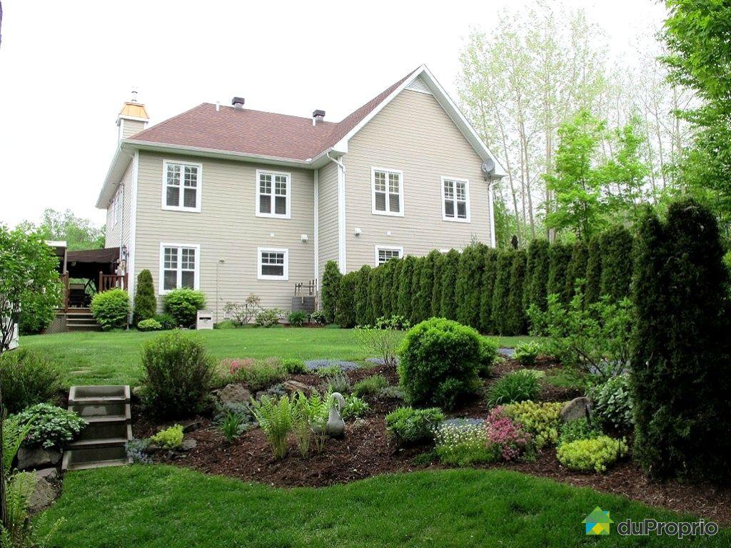 Maison vendu piedmont immobilier qu bec duproprio 333984 for Amenagement paysager facade