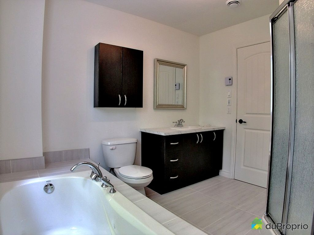 Newly built house sold in pr vost duproprio 377252 for Bathroom furniture quebec