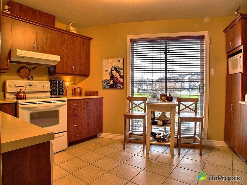 Condo vendu ste julie immobilier qu bec duproprio 293748 for Rideau pour porte patio cuisine