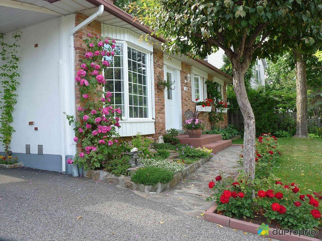 Maison vendu loretteville immobilier qu bec duproprio for Amenagement jardin facade maison
