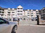 Condominium in Rocky Ridge, Calgary - NW