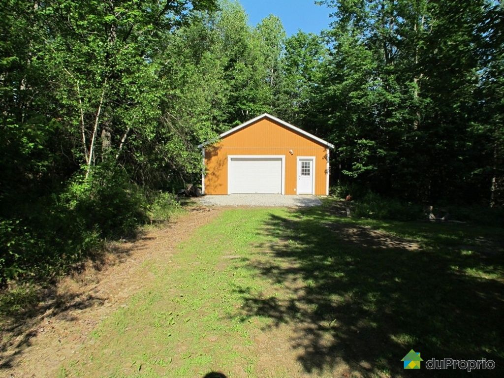 Bungalow sur lev for sale in austin 72 chemin north for Homes with big garages for sale
