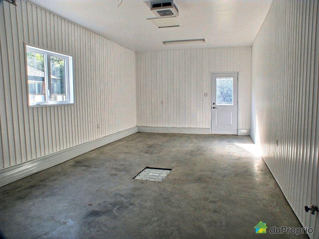 photos.duproprio.com/garage-maison-neuve-a-vendre-st-nicolas-quebec-province-large-3160467.jpg