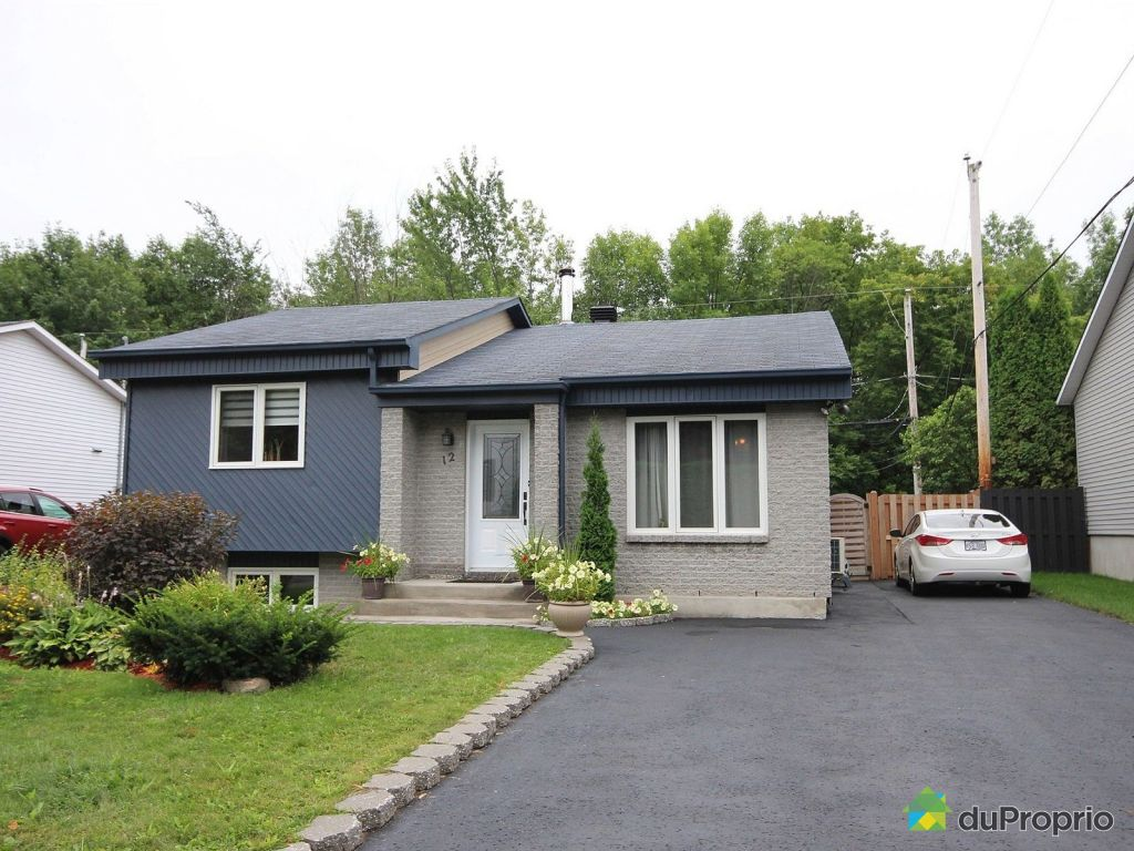 Maisons le masson laval latest two or more storey in for Decoration maison laval