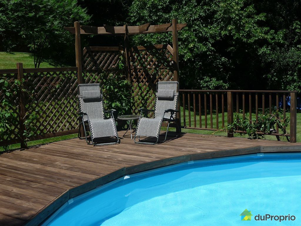 Patio designs design patio quebec for Piscine hors terre design