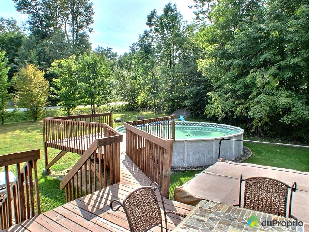 Patio designs design patio quebec for Amenagement piscine hors sol bois
