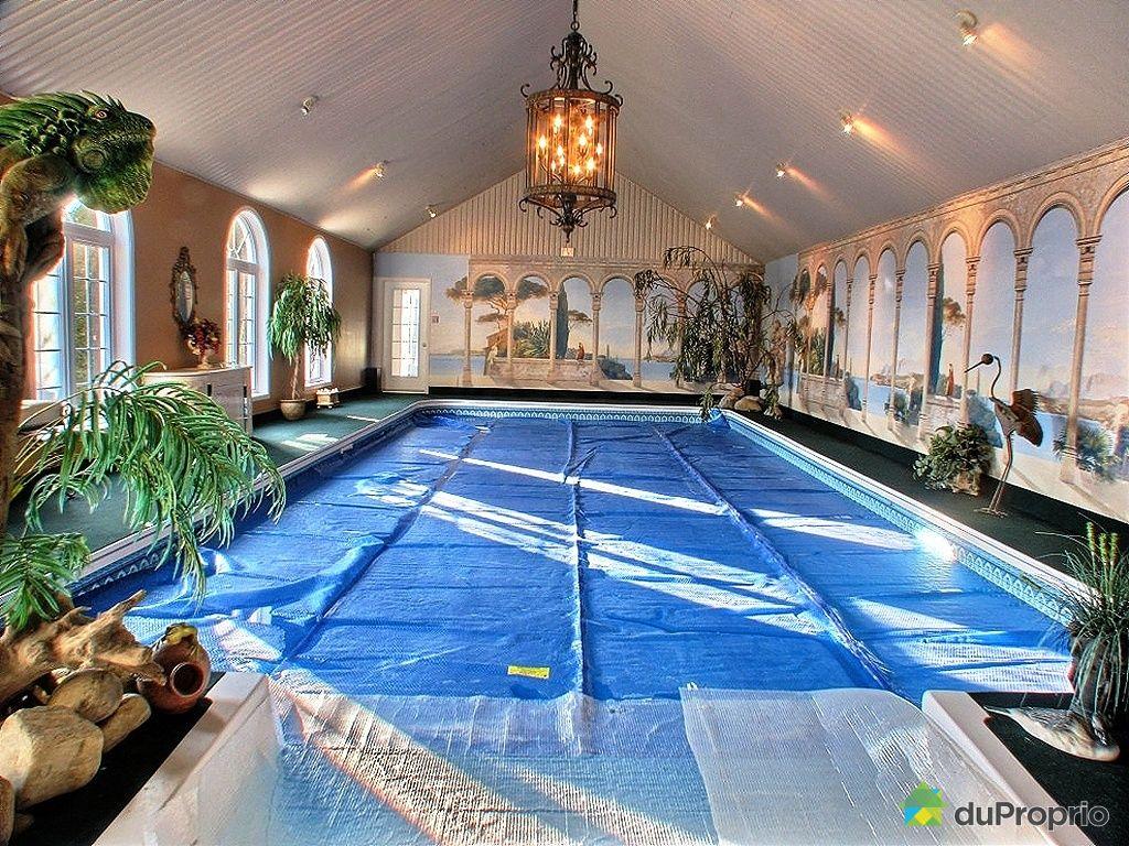 Maison a vendre avec piscine interieur for Garage interieur a louer montreal