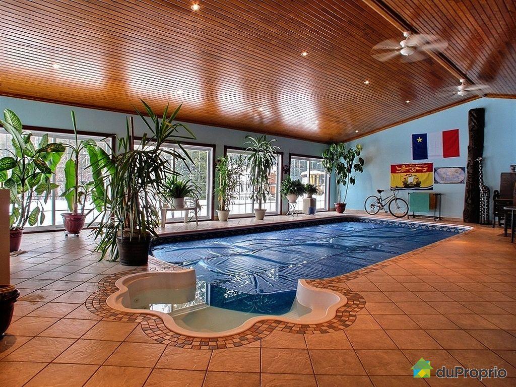 Maison à vendre st ferdinand 1030 route des chalets immobilier piscine intérieure privée chauffée avec