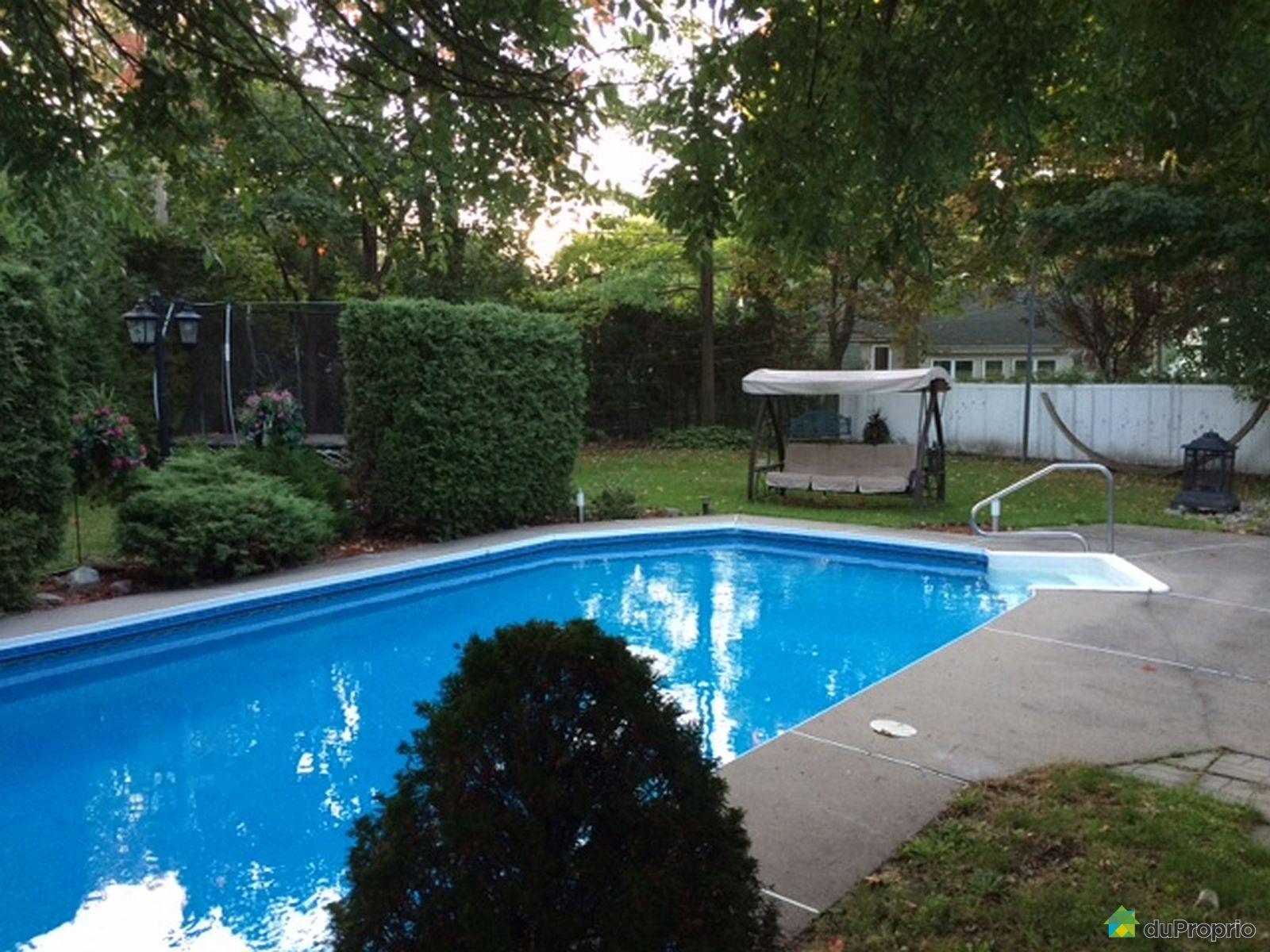 Piscine boisbriand for Reduire profondeur piscine beton