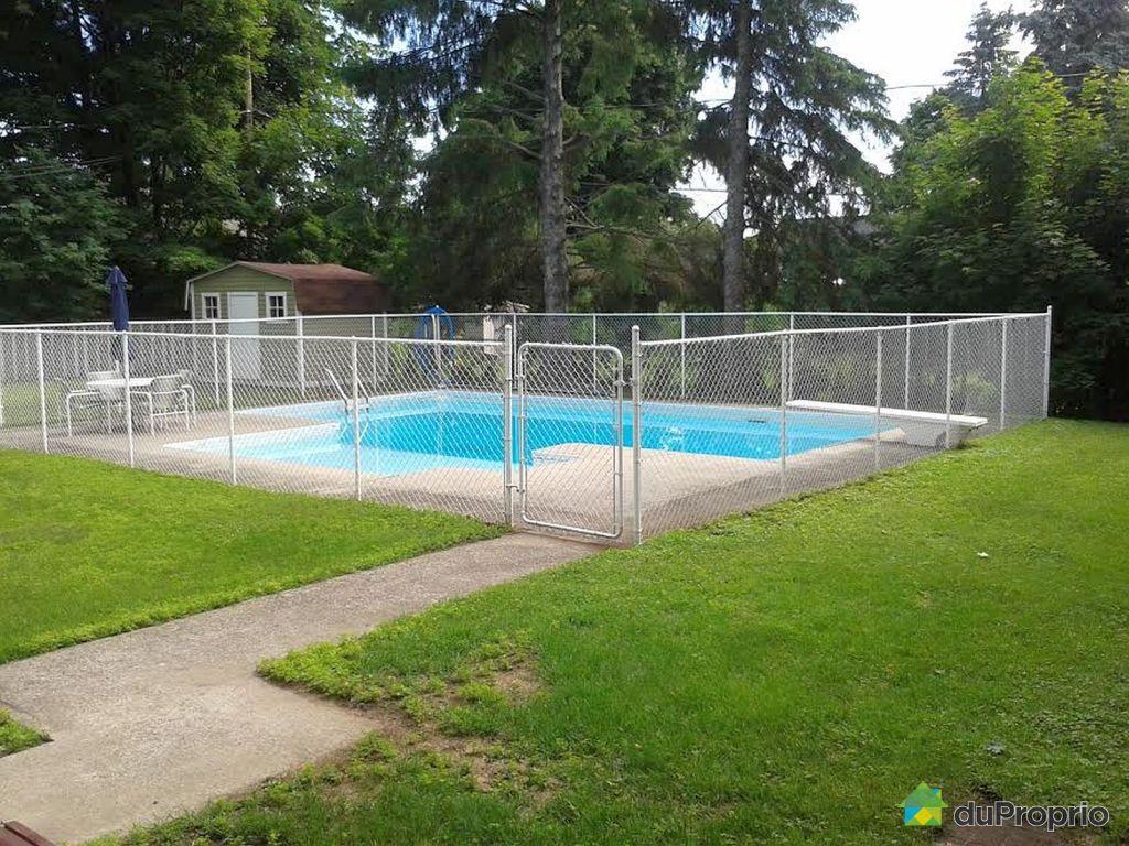 Maison vendu buckingham immobilier qu bec duproprio for Chauffe piscine au gaz