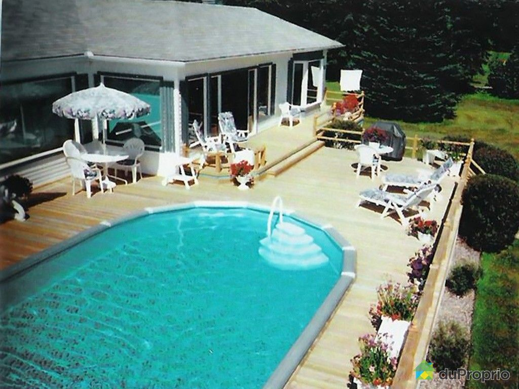 Maison vendre lac a la tortue 580 rue 98e immobilier for Piscine radiant quebec