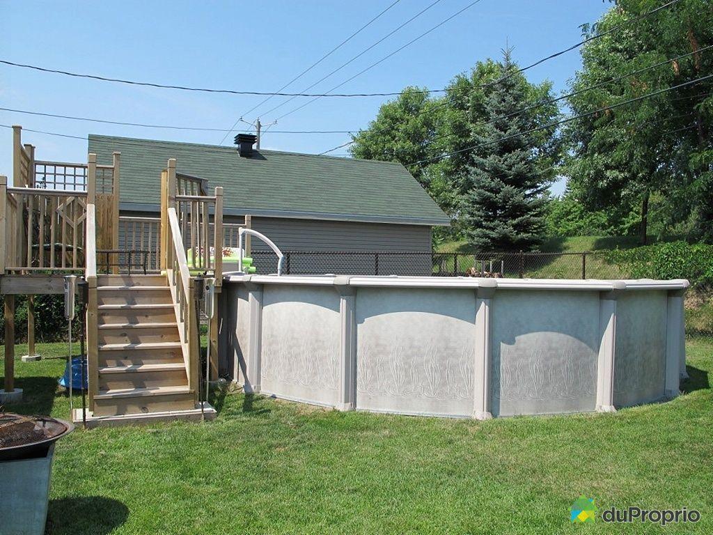 Maison vendu ste marthe sur le lac immobilier qu bec for Piscine 21 pieds litres