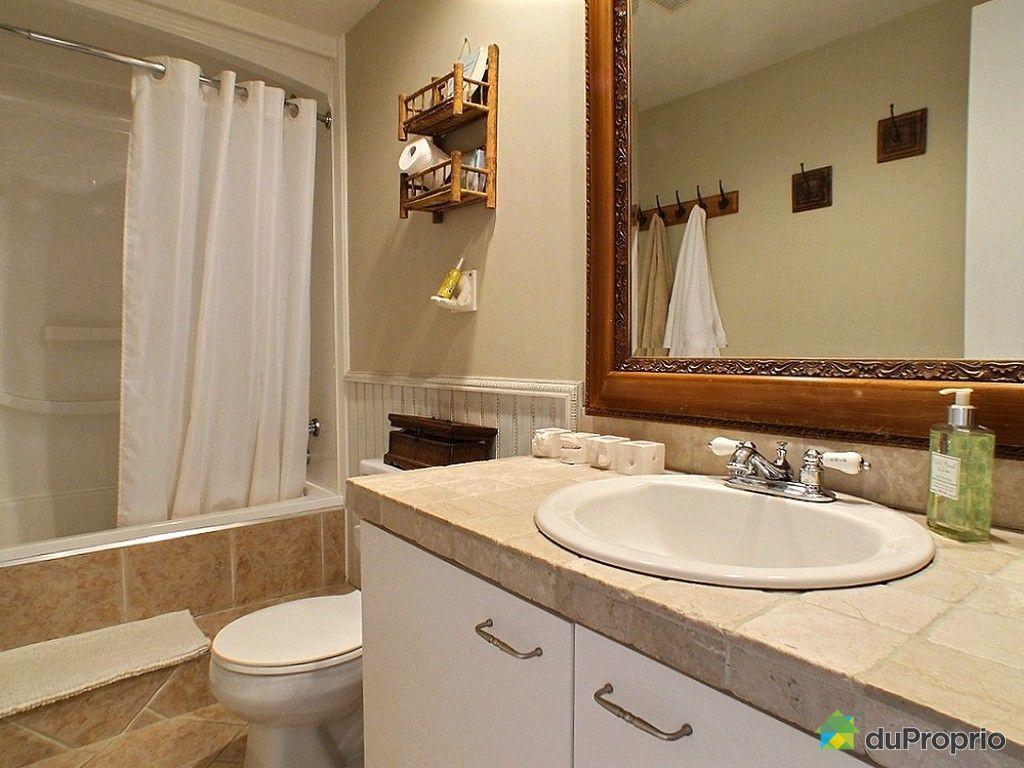 Condo vendu laval des rapides immobilier qu bec for Salle de bain laval