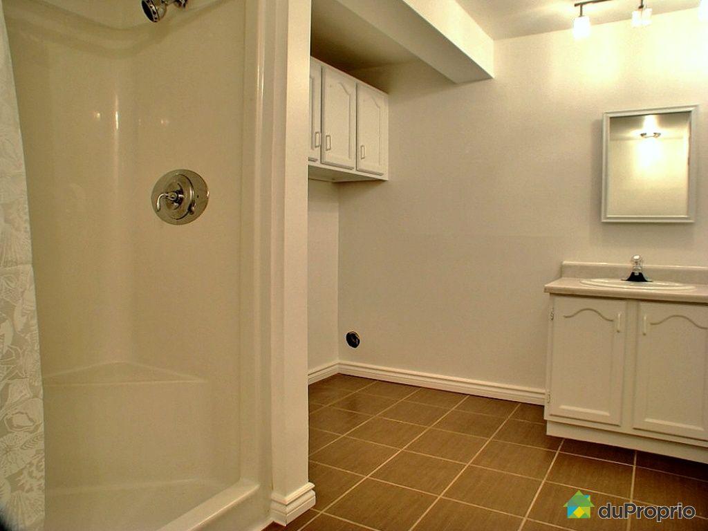 Maison vendu boucherville immobilier qu bec duproprio for Plomberie salle de bain au sous sol