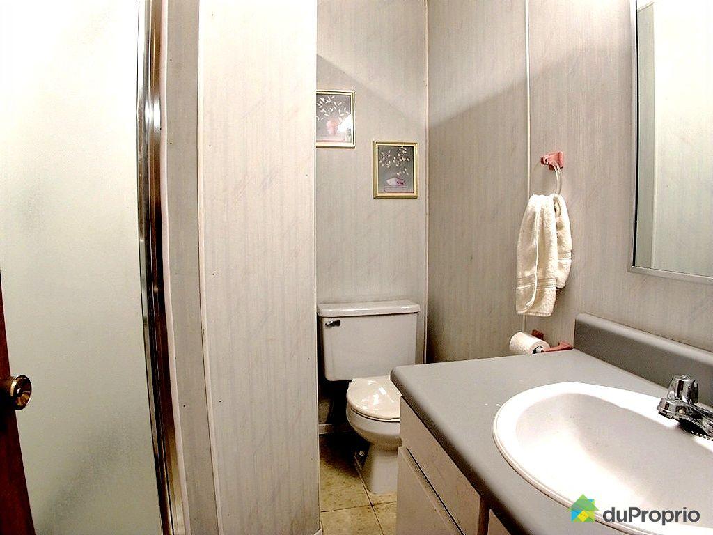 Maison vendu cap de la madeleine immobilier qu bec for Salle de bain sous sol sans fenetre