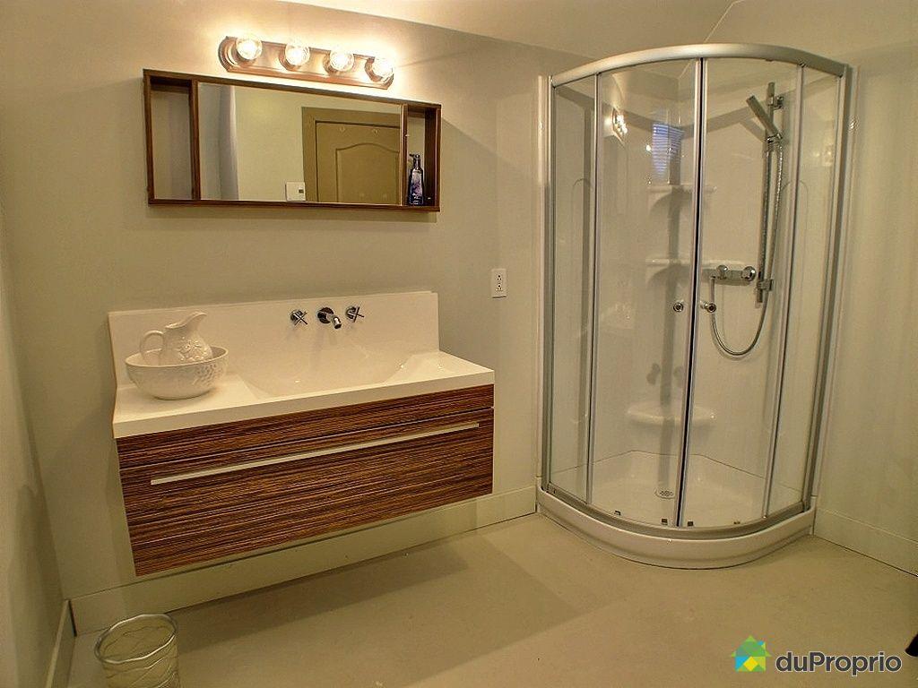 Maison vendu l 39 ancienne lorette immobilier qu bec for Salle de bain sous sol sans fenetre