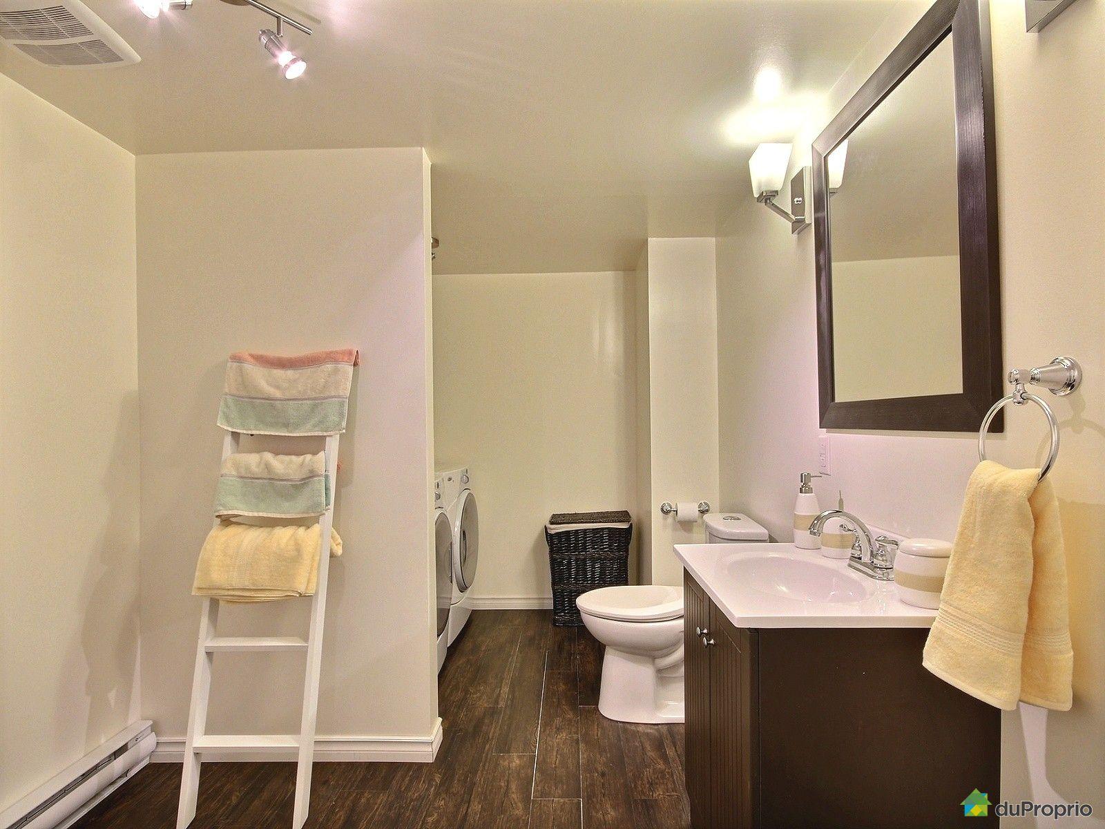 Maison vendu ste marthe sur le lac immobilier qu bec for Salle de bain sous les combes
